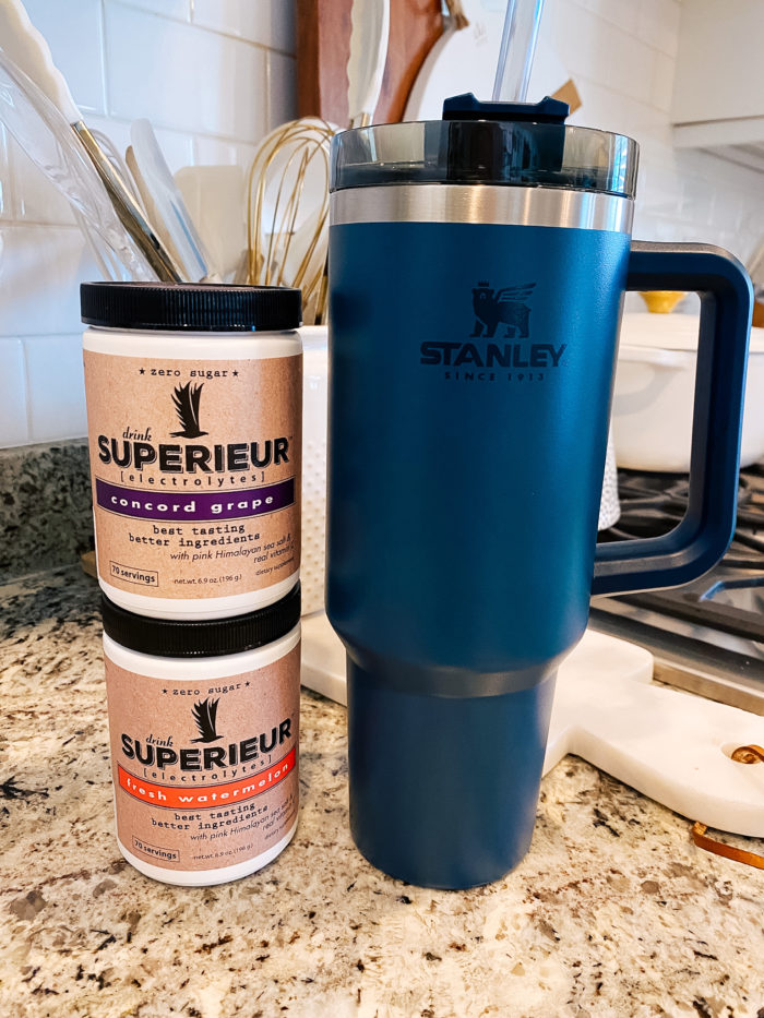 Stanley Travel Mug by popular Utah lifestyle blog, A Slice of Style: image of a blue Stanley travel mug next to Superieur electrolytes powder.