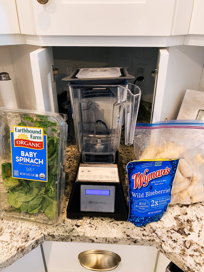 Epstein-Barr Virus by popular Utah lifestyle blog, A Slice of Style: image of organic baby spinach, Wymans wild blueberries, bananas, and a blendtec blender.