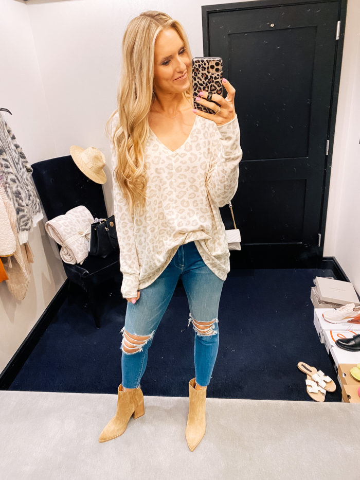 Nordstrom Anniversary Sale by popular Utah fashion blog, A Slice of Style: image of Jenica Parcell wearing a Nordstrom leopard print sweater, distressed denim, and tan suede ankle boots.