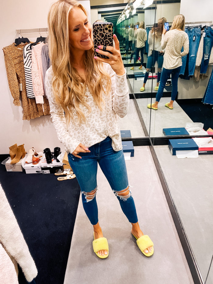 Nordstrom Anniversary Sale by popular Utah fashion blog, A Slice of Style: image of Jenica Parcell wearing a Nordstrom leopard print sweater, distressed denim, and yellow open toe slippers.