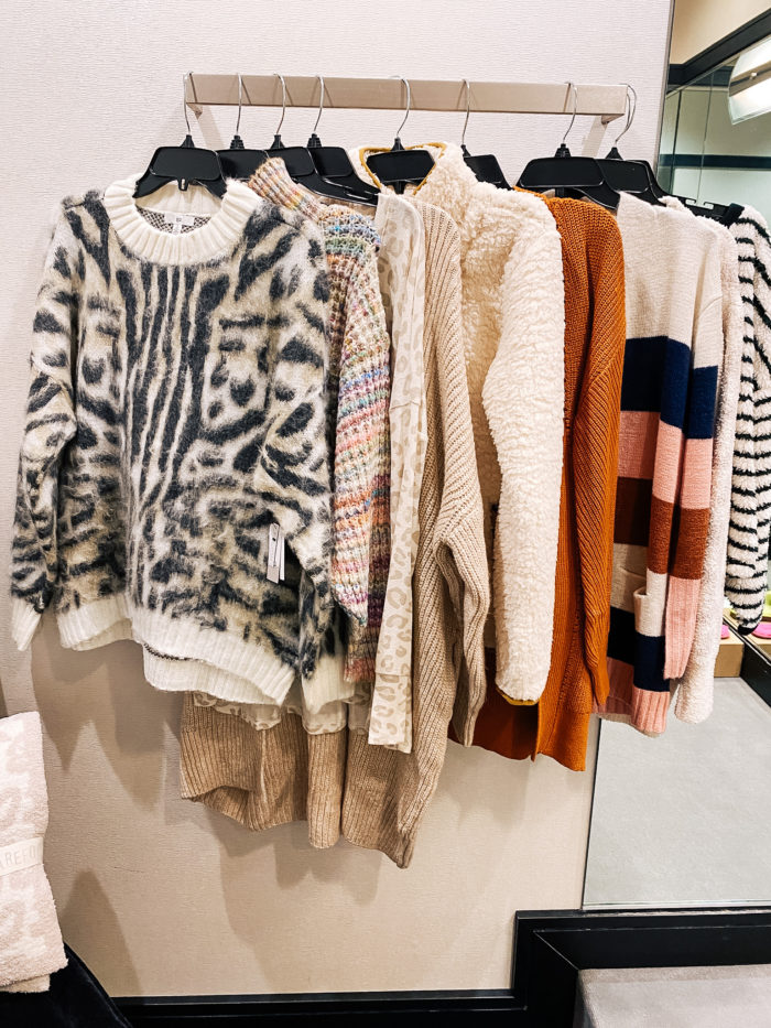 Nordstrom Anniversary Sale by popular Utah fashion blog, A Slice of Style: image of some Nordstrom sweaters hanging on a clothing rack.