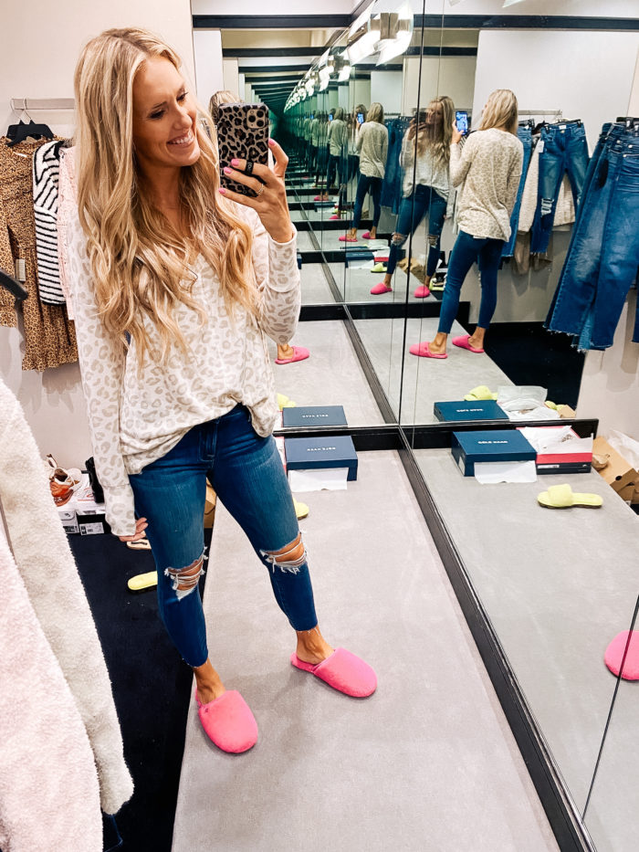 Nordstrom Anniversary Sale by popular Utah fashion blog, A Slice of Style: image of Jenica Parcell wearing a Nordstrom leopard print sweater, distressed denim, and pink UGG slippers.