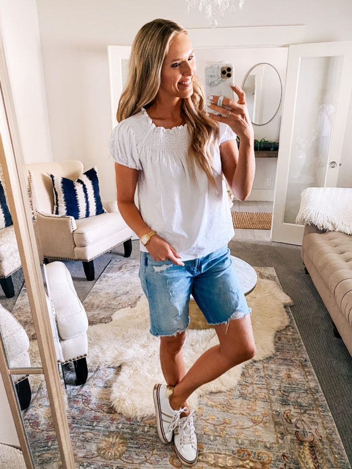 Makeup Routine by popular Utah beauty blog, A Slice of Style: image of Jenica Parcell wearing a white smocked top, jean shorts, and white sneakers.